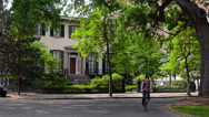 Stock Video Footage of Savannah Georgia street scene on Chorlton Street with trees and old homes in
