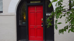 Savannah Georgia Southern city close up of red door on Charlton Street in Stock Footage