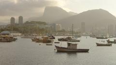 Pan of anchored boats in a hazy Rio marina. Stock Footage