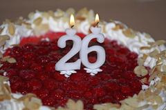 Birthday cake and candles number twenty six - stock photo