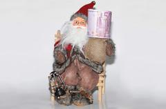 Santa is giving  cash from his sack Stock Photos
