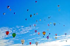 Colorful air balloons on blue sky Stock Photos