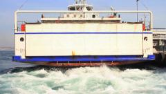 City car ferry-boat sailing out from Sirkeci Stock Footage