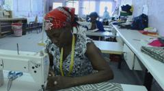 Windhoek Namibia Namibia woman sewing fabrics and crafts at Penduka Craft Center Stock Footage
