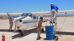 Namibia Namib Desert refueling plane in the Hartmann Berge Marienflub sand Stock Footage