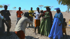 Namibia Namibia Northern Desert tourists relating with colorful Herero tribe Stock Footage