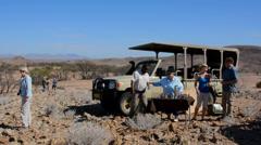 Namibia Namibia desert tourists having morning coffee in safari at Uibasen Stock Footage