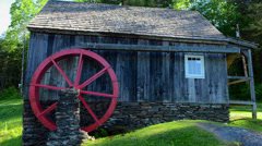 Rockingham Vermont old barn mill with paddle wheel red in woods Stock Footage