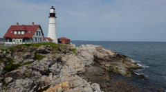 Portland Maine famous Head Light Lighthouse in USA  on water with rocks and Stock Footage
