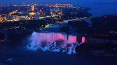Niagara Falls New York and the American Falls and Bridal Falls at night colors Stock Footage