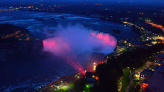 Niagara Falls New York and the American Falls and Bridal Falls at night colors Stock Footage