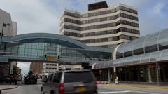 Stock Video Footage of Anchorage Alaska capital city traffic on 5th Avenue Town Square Park area with