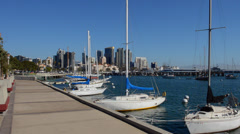 City of San Diego skyline with boats at Harbor Island in California with skyline Stock Footage