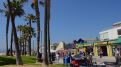 Venice California CA boardwalk with tourists walking with shops interesting Stock Footage