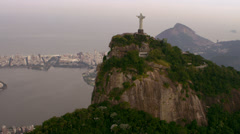 Aerial video of Art Deco Statue, Lagoa, and Rio de Janeiro. - stock footage