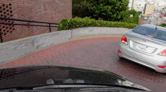 San Francisco California famous drive down Lombard Street with curves and turns Stock Footage