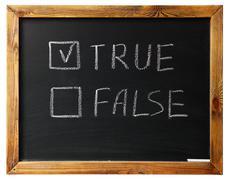 true or false on black chalk board - stock photo