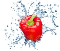 pepper in spray of water. - stock photo