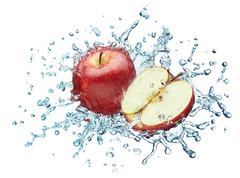 Apple in spray of water. Stock Photos