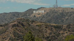 Los Angeles California CA with famous big HOLLYWOOD sign on hill Stock Footage