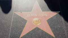 Los Angeles California CA Elton John star atthe famous TCL Chinese Theater with Stock Footage