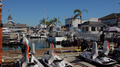 Balboa Beach at Newport Beach California CA marina at harbor and boats Stock Footage