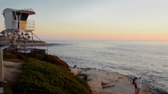 San Diego California CA La Jolla sunset at The Cove with beach and lifeguard Stock Footage