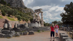 Stock Video Footage of Greece Delphi famous Greek Temple of Athena tourists taking photos at place of