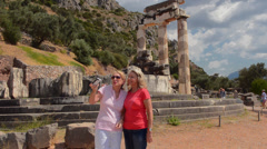 Greece Delphi famous Greek Temple of Athena tourists taking photos at place of Stock Footage