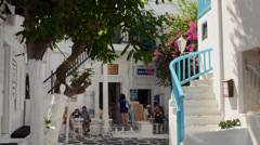Mykonos Greece blue stairs and flowers in Mikonos Center downtown beaiutiful Stock Footage