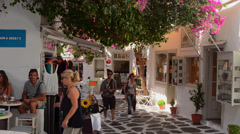 Mykonos Greece center of island with shops and shoppers walking thru city  and Stock Footage