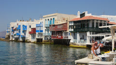 Mykonos Greece beautiful Little Venice restaurants and bars on water for Stock Footage