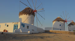 Mikonos Greece famous five old 14th Century Windmills of white at sunrise Stock Footage
