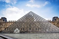 paris - march 26: pyramid and louvre museum (former royal palace). louvre is - stock photo