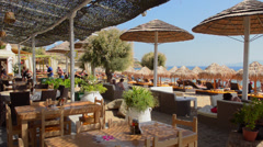 Greece Mykonos Paradise Beach beach restaurant Kalo Livadi resort that singles Stock Footage