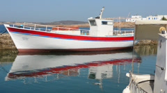 Greece Paros Cyclades Naousa or Naouusa fishing boats in port in city center Stock Footage