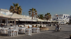 Greece Paros Cyclades Naousa or Naouusa frestaurant with tables  in port in city Stock Footage