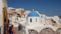 Stock Video Footage of Greece Santorini Oia Cyclades white buildings and steep mountains Greek Islands