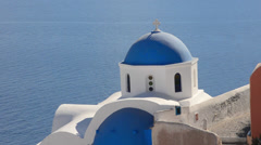 Greece Santorini Oia Cyclades blue church dome and steep mountains Greek Islands Stock Footage