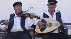 Greece Santorini Oia Cyclades band playing music with guitar and violin musical Stock Footage