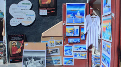 Greece Santorini Oia Cyclades paintings for sale as souvenirs Greek Islands Stock Footage