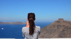 Santorini Greece young  woman taking video with Iphone on holiday having fun on Stock Footage