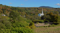 Fall colors of Stowe Vermont in New England with Church steeple of Stowe Stock Footage