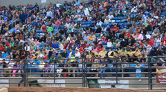 Pan crowd at rodeo or outdoor stadium event Stock Footage