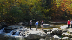 Jeffersonville Vermont Bryan Canyon Brewster River people walking on rocks Stock Footage
