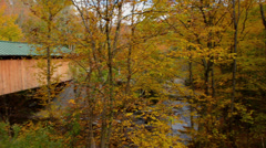 Montgomery Center Vermont Hutchins Bridge 1883 fall foliage with colors in trees Stock Footage
