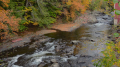 Johnson Vermont rapids on river by Power House Bridge in fall foliage in Stock Footage