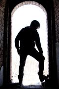 silhouette of a man in arch - stock photo