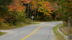 Northern Vermont mountains roads with cars traveling in fall foilage colors in Stock Footage