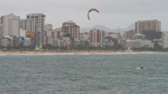 Stock Video Footage of Parasailing surfer is distance from shore and goes under.